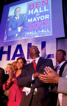 Saundra Hall stands next to her husband, Houston mayoral candidate Ben Hall, as he takes in the room before addressing his supporters during the candidates  election night party Tuesday November 5, 2013 at the House of Dereon at 2204 Crawford St. in Houston, TX. Photo: Billy Smith II, Chronicle / © 2013 Houston Chronicle