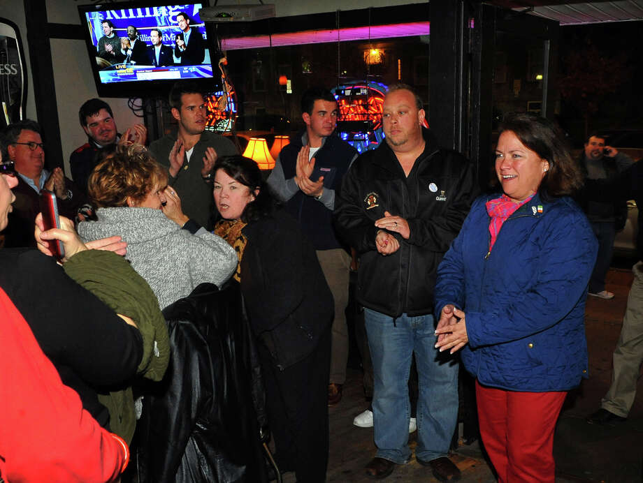 Incumbent Susan Brannelly, who won re-election to the Bridgeport City Council, enters Matty's Corner to celebrate in Bridgeport, Conn. on Tuesday November 5, 2013. Photo: Christian Abraham / Connecticut Post