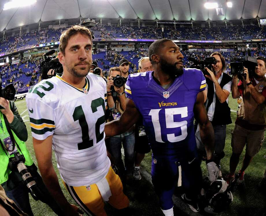 MINNEAPOLIS, MN - OCTOBER 27: Aaron Rodgers #12 of the Green Bay Packers and Greg Jennings #15 of the Minnesota Vikings speak after the game on October 27, 2013 at Mall of America Field at the Hubert H. Humphrey Metrodome in Minneapolis, Minnesota. The Packers defeated the Vikings 44-31. (Photo by Hannah Foslien/Getty Images) ORG XMIT: 179697358 Photo: Hannah Foslien / 2013 Getty Images