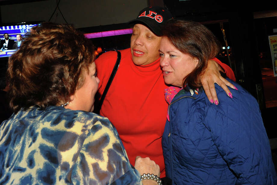 Bridgeport City Council incumbent Susan Brannelly, at right, who won re-election to the Bridgeport City Council, gets a hug from fellow councilwoman Evette Brantley while celebrating at Matty's Corner to celebrate in Bridgeport, Conn. on Tuesday November 5, 2013. Photo: Christian Abraham / Connecticut Post