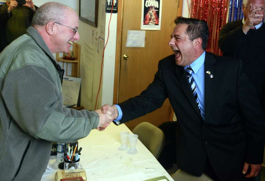 Alderman-elect Charles Stowe and Republican David Cassetti shake hands after winning their races in  Ansonia, Conn. Tuesday, Nov. 5, 2013. Photo: Autumn Driscoll / Connecticut Post