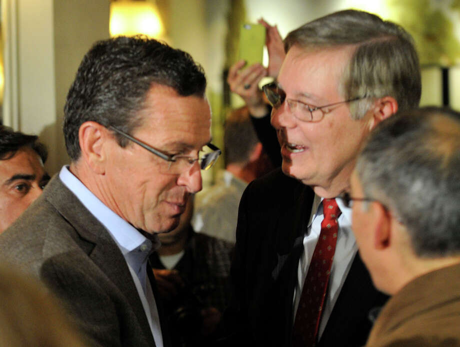 Gov. Dannel P. Malloy talks with mayor-elect David Martin during election night at the Democratic headquarters at the Stamford Mariott in Stamford, Conn., on Tuesday, Nov. 5, 2013. Photo: Jason Rearick / Stamford Advocate