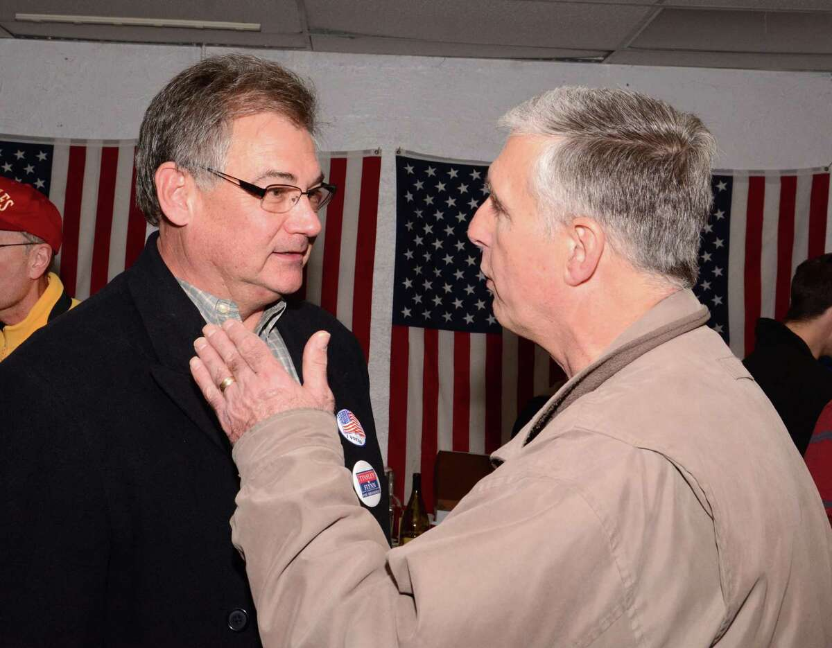 Brookfield Republican elected First Selectman, Bill Tinsley, chats with Jeff Rossi, who won for Board of Finance at the Republican Headquarters in Brookfield on Tuesday, Nov. 5, 2o013.