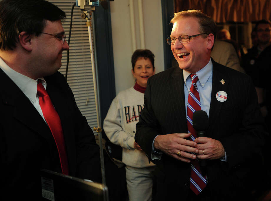 Chris Silhavey, left, introduces Stratford Mayor John Harkins after his defeat of Democratic challenger Joe Paul at Republican headquarters in Stratford, Conn. on Tuesday, November 5, 2013. Photo: Brian A. Pounds / Connecticut Post