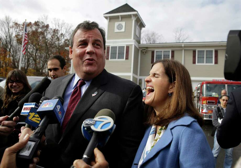New Jersey first lady, Mary Pat Christie, laughs as husband, Republican New Jersey Gov. Chris Christie, jokes with the media after they voted in Mendham Township, N.J., Tuesday, Nov. 5, 2013. Christie is facing Democratic challenger Barbara Buono in Tuesday's election. (AP Photo/Mel Evans) ORG XMIT: NJME105 Photo: Mel Evans / AP