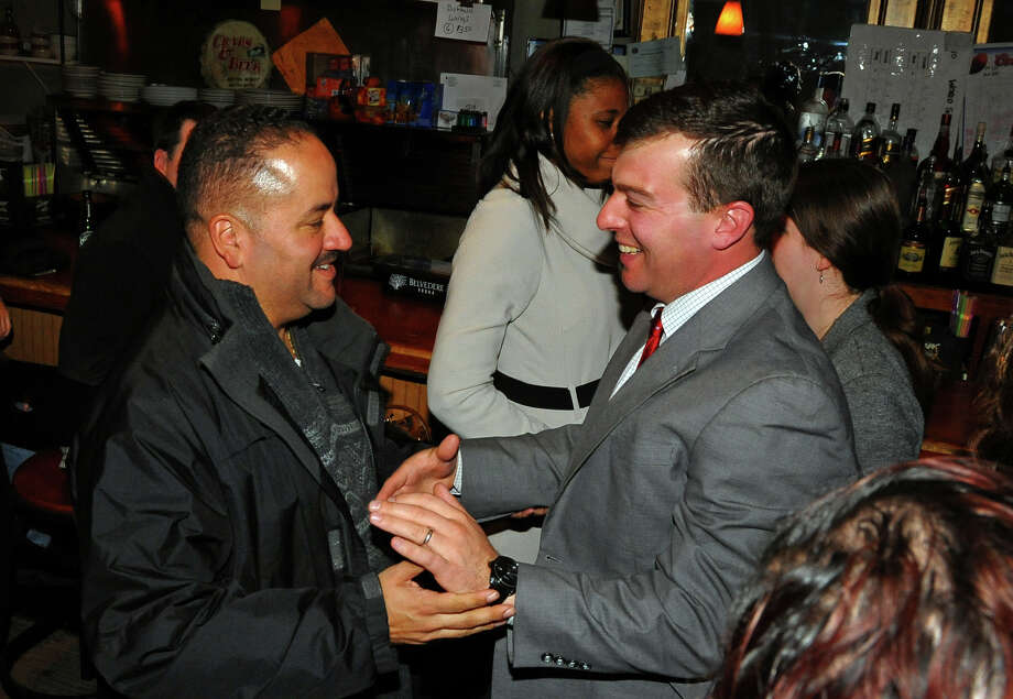 Bridgeport City Council incumbent Steven Stafstrom, who lost re-election, at right, greets State Senator Andres Ayala Jr. at Matty's Corner in Bridgeport, Conn. on Tuesday November 5, 2013. Photo: Christian Abraham / Connecticut Post