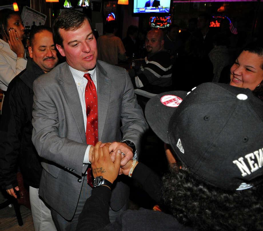 Bridgeport City Council incumbent Steven Stafstrom, who lost re-election, at right, greets and thanks a supporter at Matty's Corner in Bridgeport, Conn. on Tuesday November 5, 2013. Photo: Christian Abraham / Connecticut Post