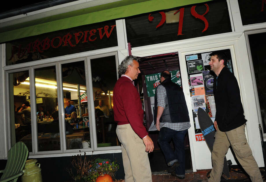 Republican candidtaes Rick Torres, left, opens the door to arriving supporters at Harborview Market in Bridgeport, Conn. on Tuesday November 5, 2013. Torres won a seat on the Bridgeport City Council, but Blagys lost his election for a seat. Photo: Christian Abraham / Connecticut Post