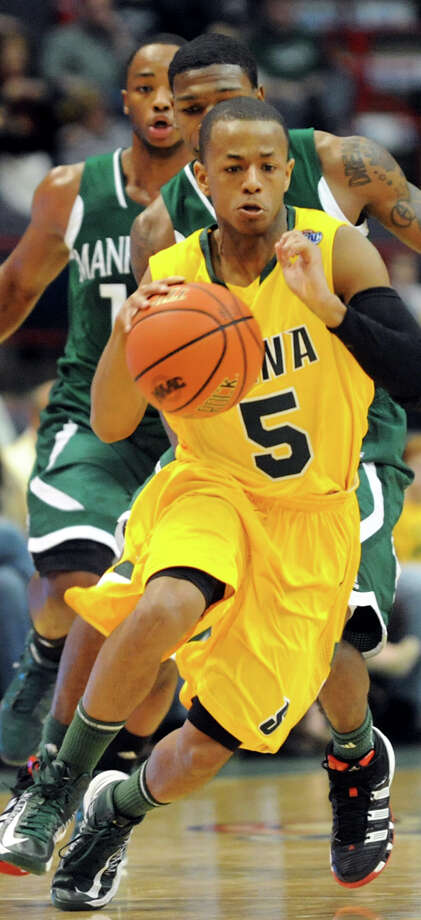 Siena's Evan Hymes (5) drives up court during their basketball game against Manhattan on Friday, Feb. 1, 2013, at Times Union Center in Albany, N.Y. (Cindy Schultz / Times Union) Photo: Cindy Schultz / 00020987A