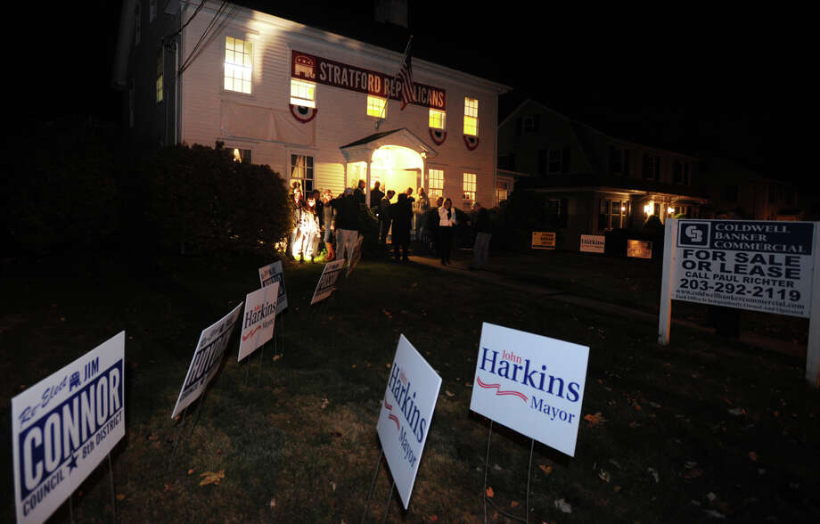 The celebration overStratford Mayor John Harkins victory over Democratic challenger Joe Paul spills out on to the lawn outside Republican headquarters in Stratford, Conn. on Tuesday, November 5, 2013. Photo: Brian A. Pounds / Connecticut Post