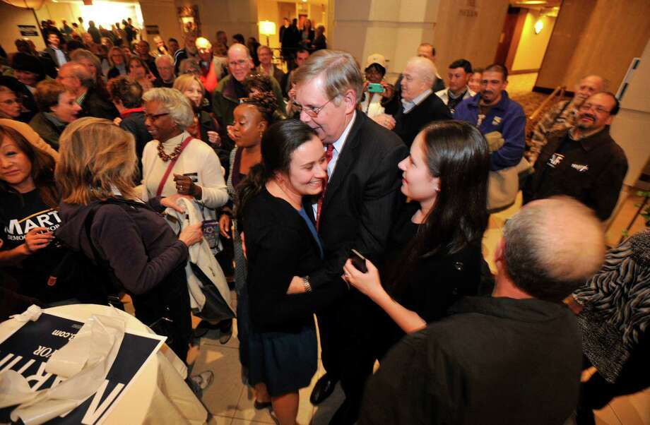 Mayor-elect David Martin is congratulated by his daughters and other supporters during election night at the Democratic headquarters at the Stamford Mariott in Stamford, Conn., on Tuesday, Nov. 5, 2013. Photo: Jason Rearick / Stamford Advocate