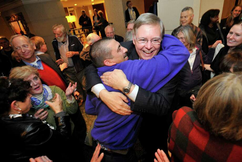 Mayor-elect David Martin is congratulated by his supporters during election night at the Democratic headquarters at the Stamford Mariott in Stamford, Conn., on Tuesday, Nov. 5, 2013. Photo: Jason Rearick / Stamford Advocate