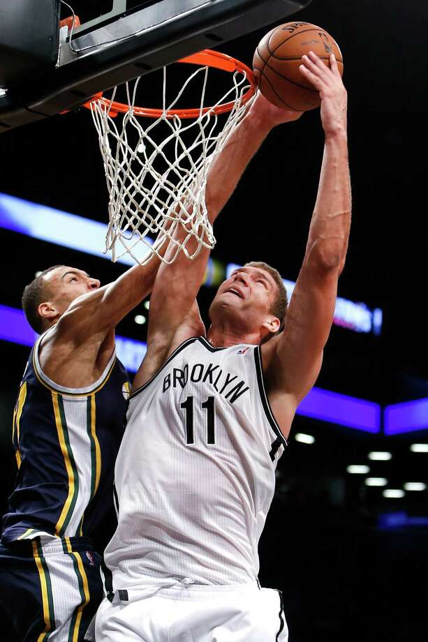 Brooklyn Nets' Brook Lopez (11) goes to the basket against Utah Jazz's Rudy Gobert during the second half of an NBA basketball game Tuesday, Nov. 5, 2013, in New York. Brooklyn won 104-88. (AP Photo/Jason DeCrow)   ORG XMIT: NYJD107 Photo: Jason DeCrow / FR103966 AP