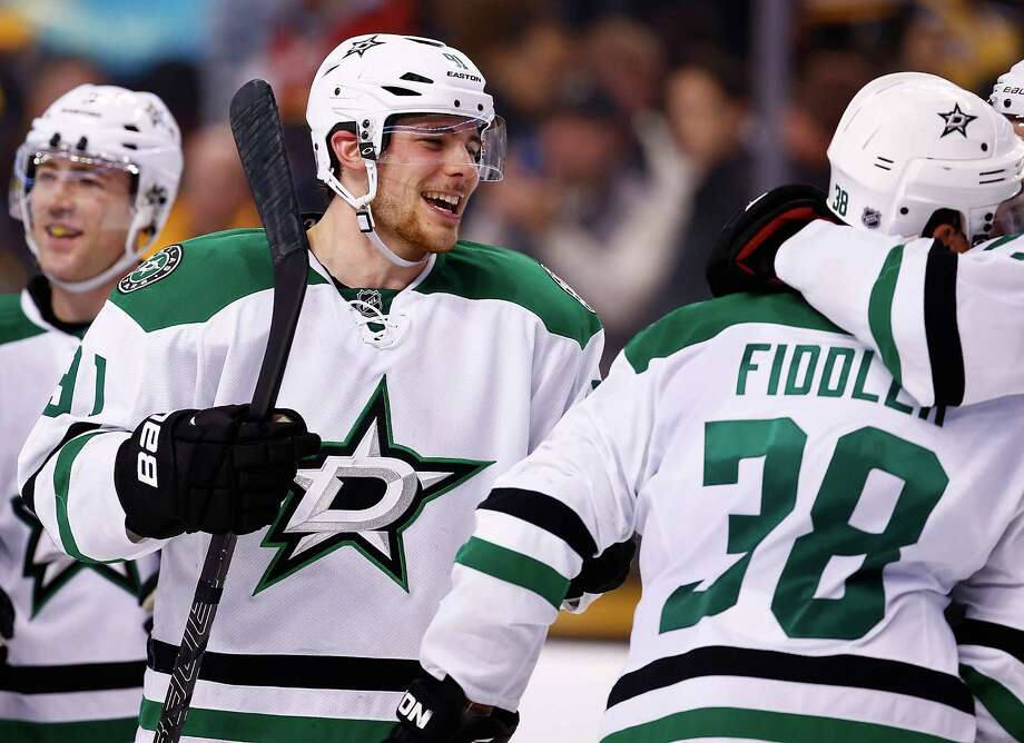 BOSTON, MA - NOVEMBER 05:  Tyler Seguin #91 of the Dallas Stars celebrates with teammates following their shootout win against the Boston Bruins at TD Garden on November 5, 2013 in Boston, Massachusetts.  (Photo by Jared Wickerham/Getty Images) ORG XMIT: 181110246 Photo: Jared Wickerham / 2013 Getty Images