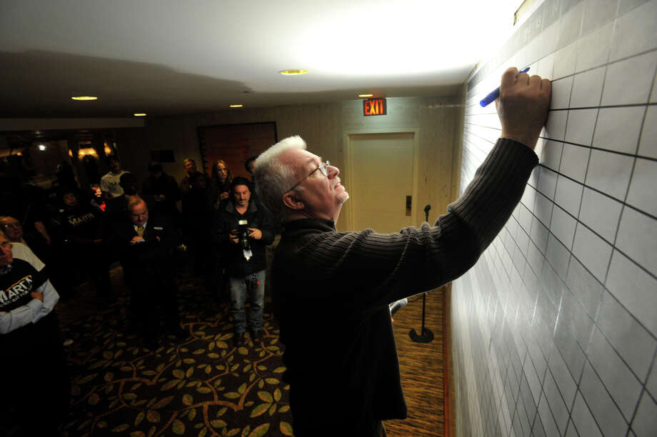 Jon Carlo Gallup displays the poll numbers for mayoral candidates during election night at the Democratic headquarters at the Stamford Mariott in Stamford, Conn., on Tuesday, Nov. 5, 2013. Photo: Jason Rearick / Stamford Advocate