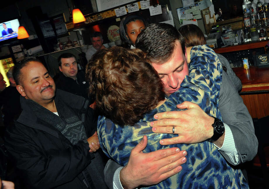 Bridgeport City Council incumbent Steven Stafstrom, who lost his bid for re-election, gets a hug from his mom Linda at Matty's Corner in Bridgeport, Conn. on Tuesday November 5, 2013. Looking on at left is State Senator Andres Ayala Jr. Photo: Christian Abraham / Connecticut Post