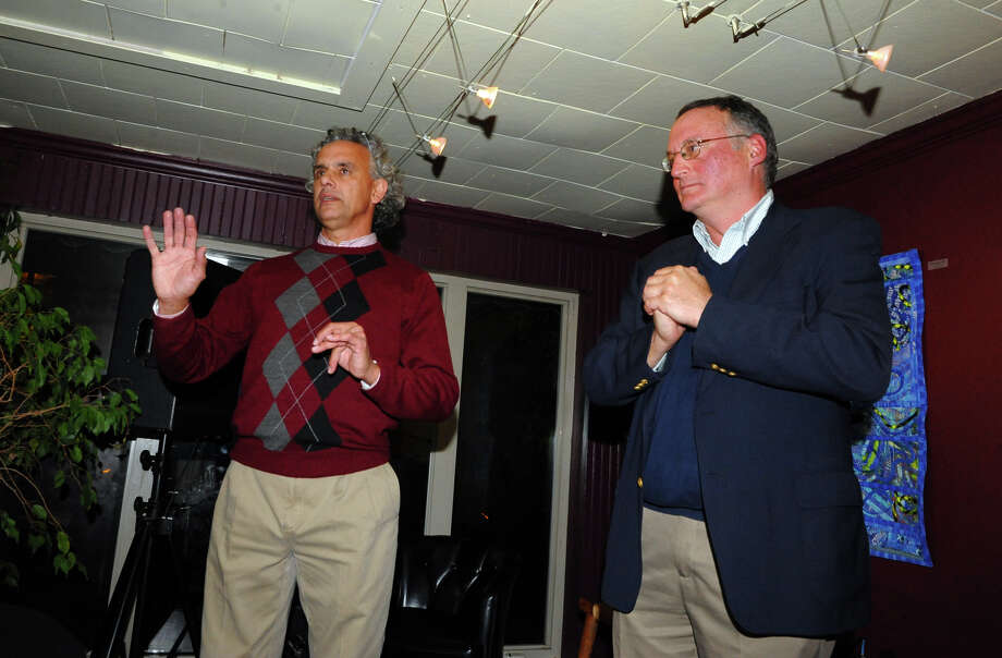 Republican candidtaes Rick Torres, left, and Phil Blagys talk to their supporters at Harborview Market in Bridgeport, Conn. on Tuesday November 5, 2013. Torres won a seat on the Bridgeport City Council, but Blagys lost his election for a seat. Photo: Christian Abraham / Connecticut Post
