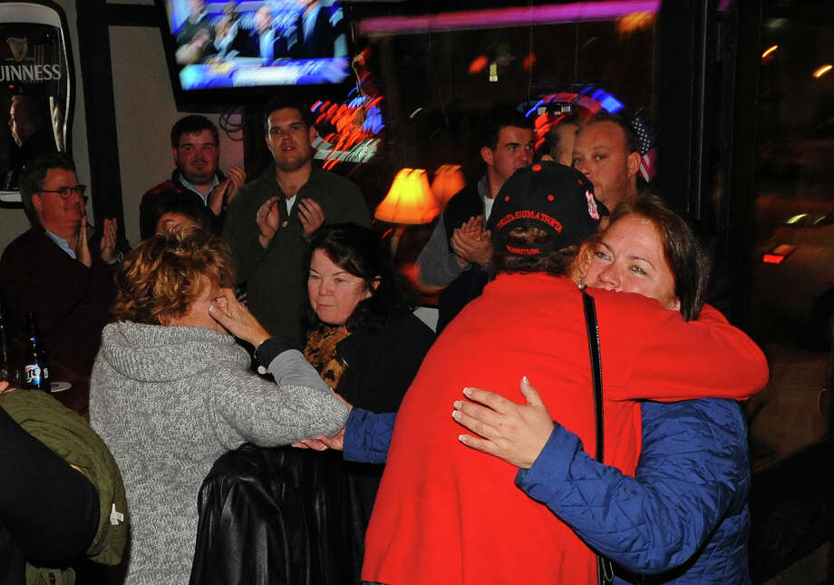 Bridgeport City Council incumbent Susan Brannelly, facing camera, who won re-election to the Bridgeport City Council, gets a hug from fellow councilwoman Evette Brantley while celebrating at Matty's Corner to celebrate in Bridgeport, Conn. on Tuesday November 5, 2013. Photo: Christian Abraham / Connecticut Post