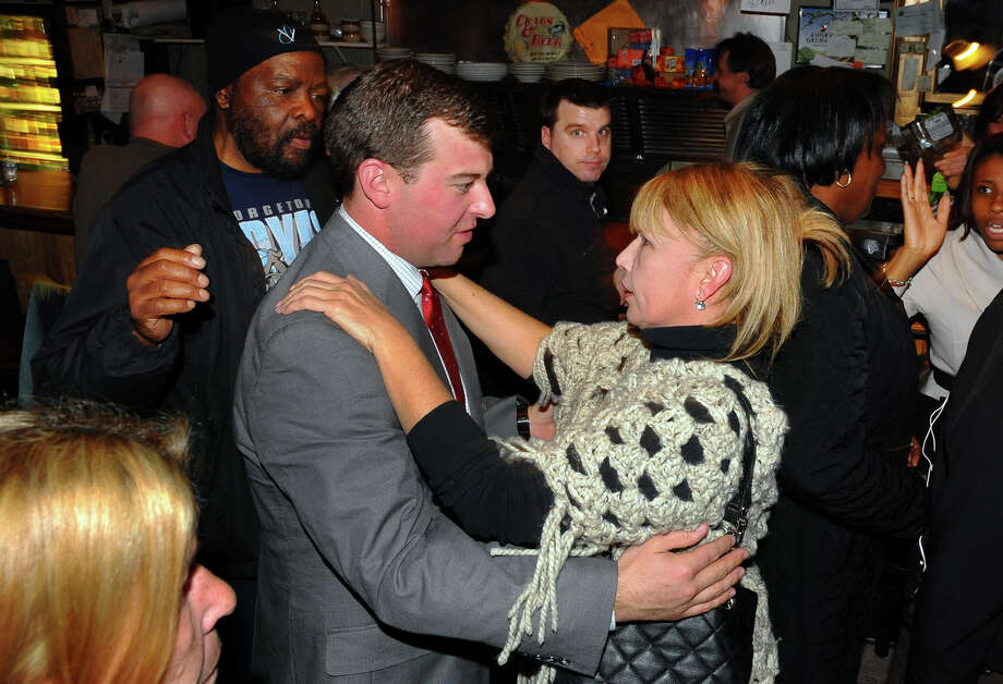 Bridgeport City Council incumbent Steven Stafstrom, who lost his bid for re-election, gets a hug from supporter Carmen Colon at Matty's Corner in Bridgeport, Conn. on Tuesday November 5, 2013. Looking on at left is State Senator Andres Ayala Jr. Photo: Christian Abraham / Connecticut Post