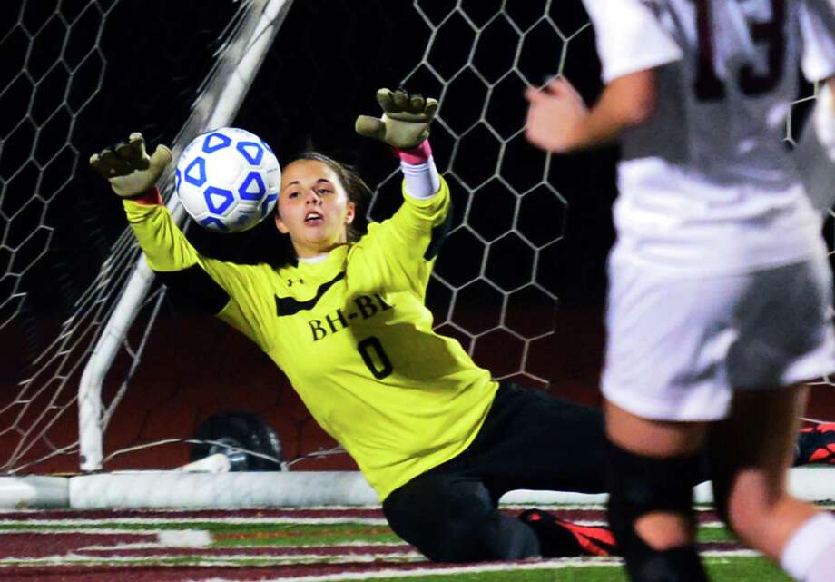Burnt Hills' goal keeper Erin Petrillose stops a Jamesville-DeWitt shot during their state regional semifinal at Stillwater High School Tuesday Nov. 5, 2013, in Stillwater, NY.  (John Carl D'Annibale / Times Union) Photo: John Carl D'Annibale / 00024512A