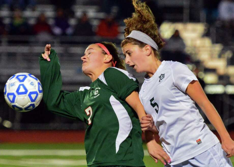 Marcellus' Brielle Filtch, left, and Schalmont's Madeline Saccocio, right, battle during the state regional soccer semifinals Tuesday Nov. 5, 2013, at Stillwater High School in Stillwater, N.Y.  (John Carl D'Annibale / Times Union) Photo: John Carl D'Annibale / 00024512A