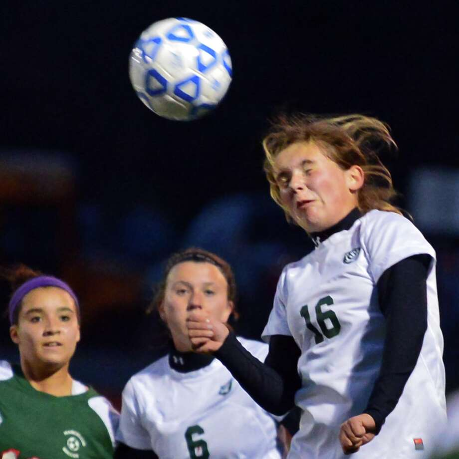 Schalmont's Alexis Horwedel, at right, heads the ball during the state regional soccer semifinals against Marcellus Tuesday Nov. 5, 2013, at Stillwater High School in Stillwater, N.Y.  (John Carl D'Annibale / Times Union) Photo: John Carl D'Annibale / 00024512A