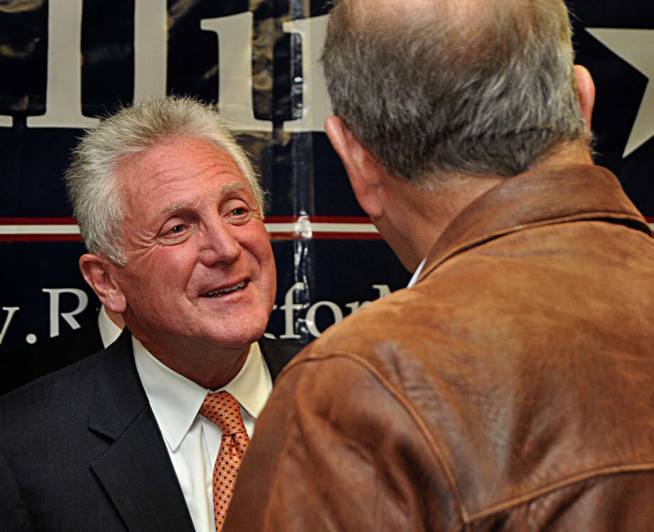 Norwalk's next mayor, former Police Chief Harry Rilling, chats with a supporter Tuesday after winning a decisive victory over Mayor Richard Moccia, who was seeking election to a fifth term. Photo: Nancy Guenther Chapman / Norwalk Citizen contributed