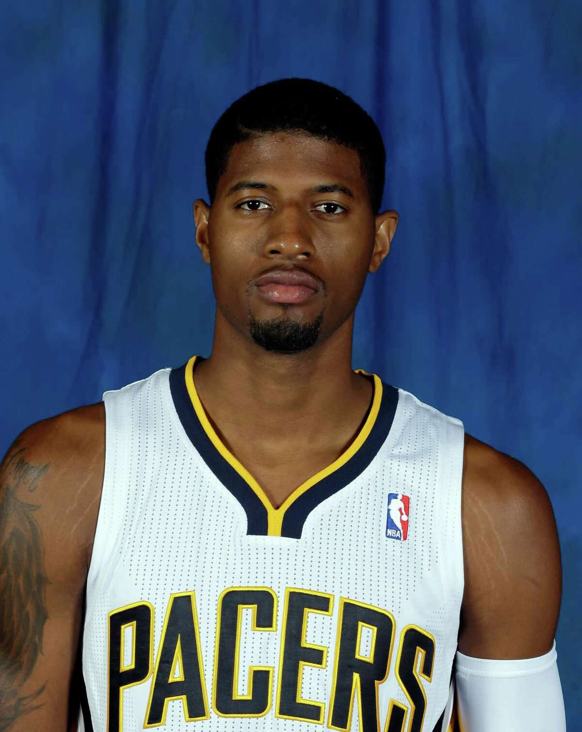 Indiana Pacers' Paul George poses for a photograph during NBA basketball media day Friday, Sept. 27, 2013, in Indianapolis. (AP Photo/Darron Cummings)