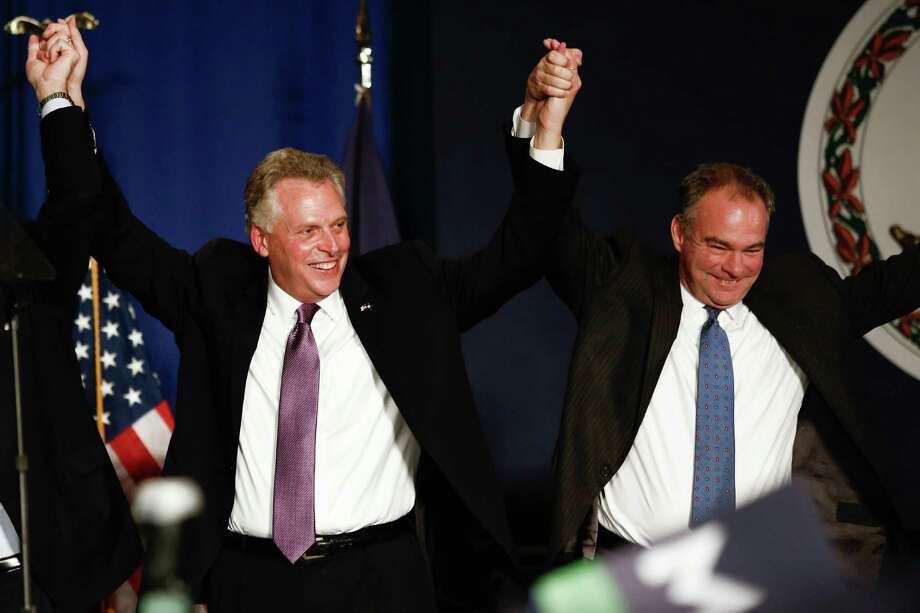 TYSONS CORNER, VA - NOVEMBER 5: (L-R), Virginia Governor-elect Terry McAuliffe (D) and Sen. Tim Kaine (D-VA) raise their hands together in celebration during an election night event, November 5, 2013 in Tysons Corner, Virginia. McAuliffe defeated state Attorney General Ken Cuccinelli. (Photo by Drew Angerer/Getty Images) ORG XMIT: 187195584 Photo: Drew Angerer / 2013  Getty Images