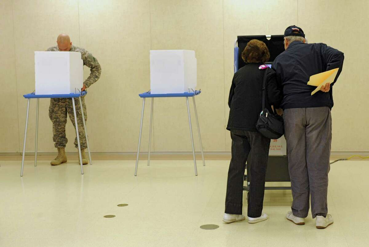 Albany residents cast their votes at Mater Christi School on election day Tuesday, Nov. 5, 2013 in Albany, N.Y. (Lori Van Buren / Times Union)
