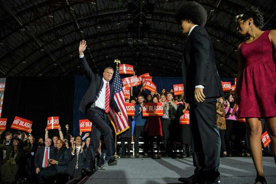 NEW YORK, NY - NOVEMBER 05:  Newly elected New York City Mayor Bill de Blasio (L) walks out on stage at his election night party on November 5, 2013 in New York City. De Blasio beat out Republican candidate Joe Lhota and will succeed Michael Bloomberg as the 109th mayor of New York City. He is the first Democratic mayor in 20 years.  (Photo by Andrew Burton/Getty Images) ORG XMIT: 187195813 Photo: Andrew Burton / 2013 Getty Images