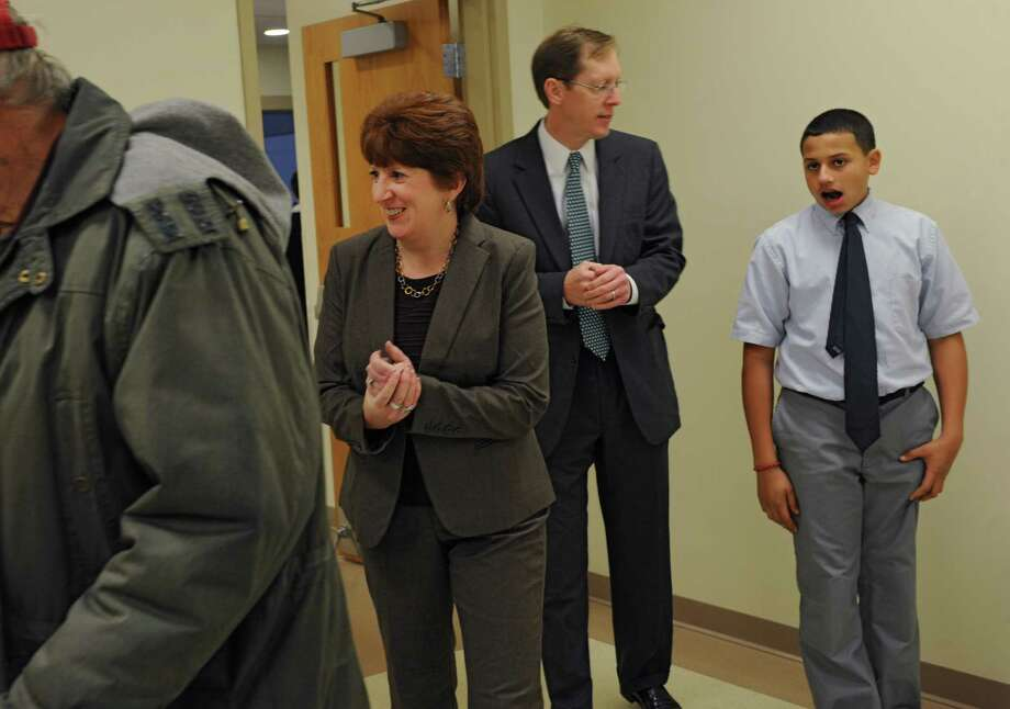 Albany mayoral candidate Kathy Sheehan shows up to vote at Mater Christi School joined by her husband Bob and son Jake on election day Tuesday, Nov. 5, 2013 in Albany, N.Y.  (Lori Van Buren / Times Union) Photo: Lori Van Buren / 00024481C