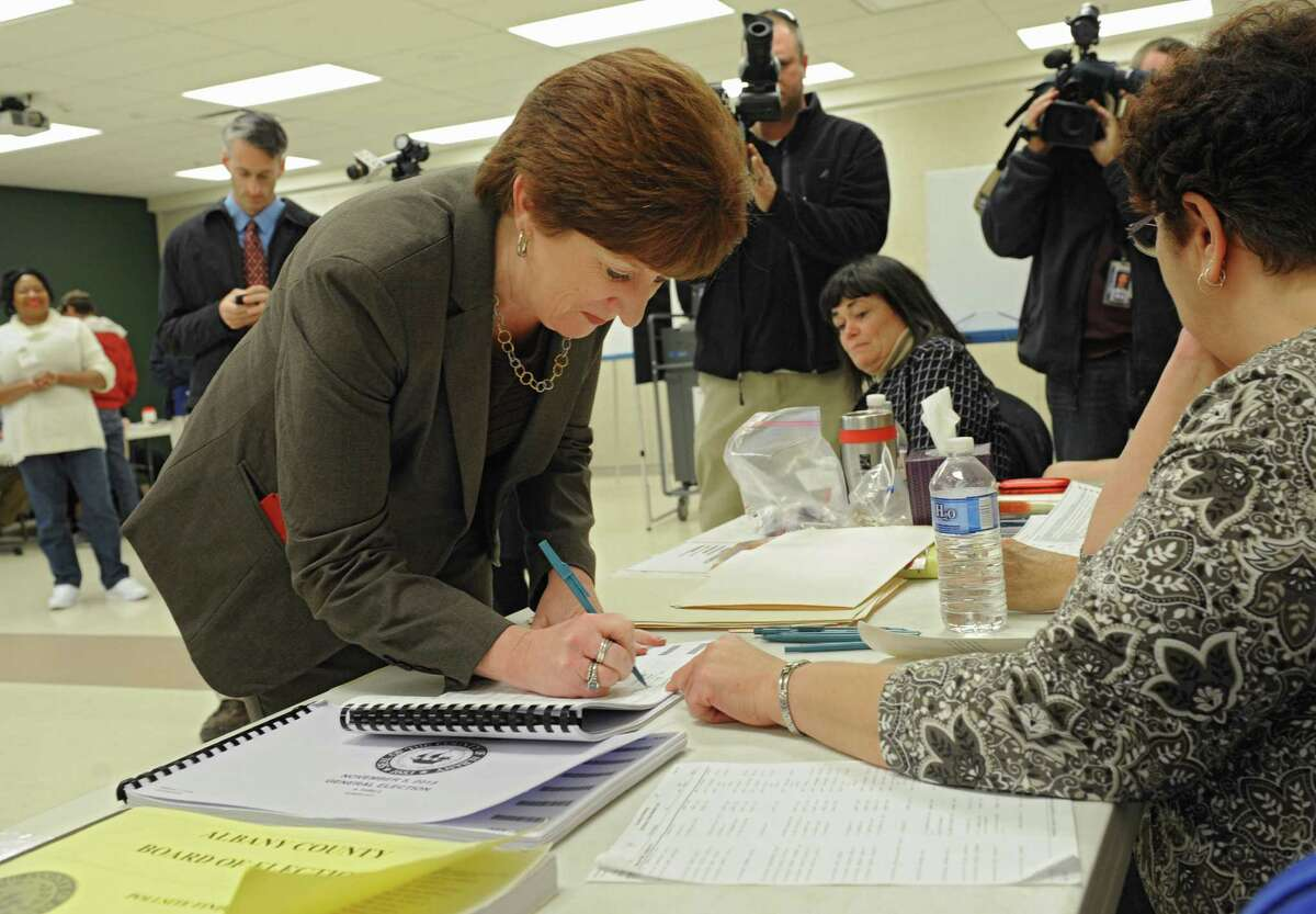 Albany mayoral candidate Kathy Sheehan signs in to vote at Mater Christi School on election day Tuesday, Nov. 5, 2013 in Albany, N.Y. (Lori Van Buren / Times Union)