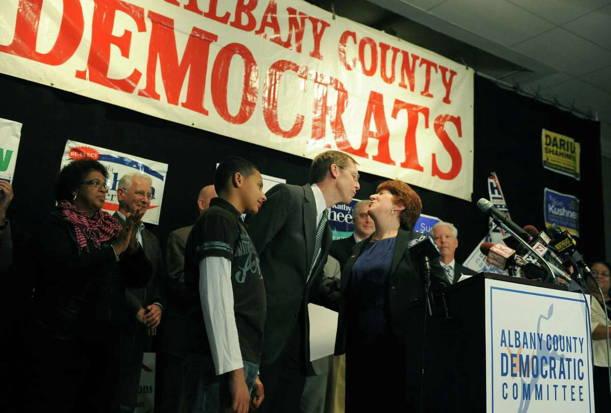Albany mayor elect Kathy Sheehan, right, kisses her husband Bob Sheehan as she gives her victory speech at the Albany County Democratic Committee party Tuesday night, Nov. 5, 2013, at the Polish Community Center in Albany, N.Y. (Michael P. Farrell/Times Union)
