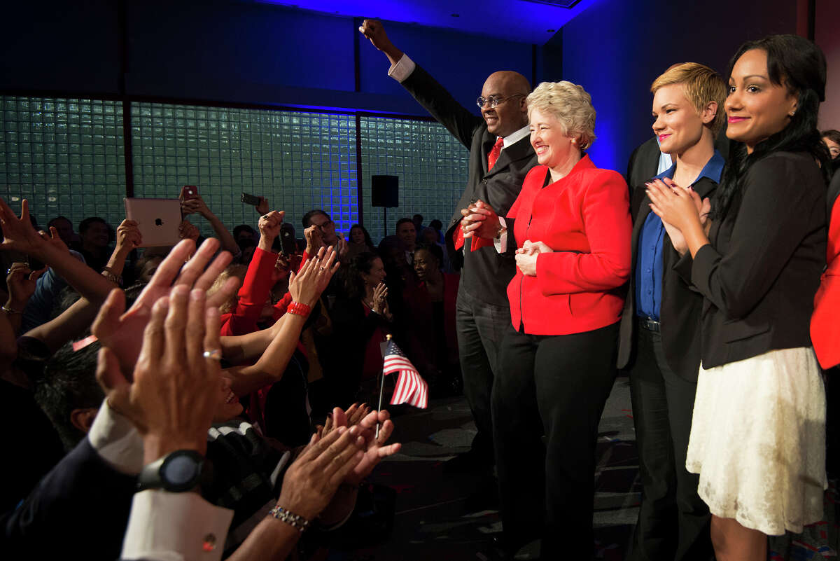 Houston mayor Annise Parker celebrates her election victory with her family during a campaign party at the George R. Brown Convention Center on Tuesday, Nov. 5, 2013, in Houston. ( Smiley N. Pool / Houston Chronicle )
