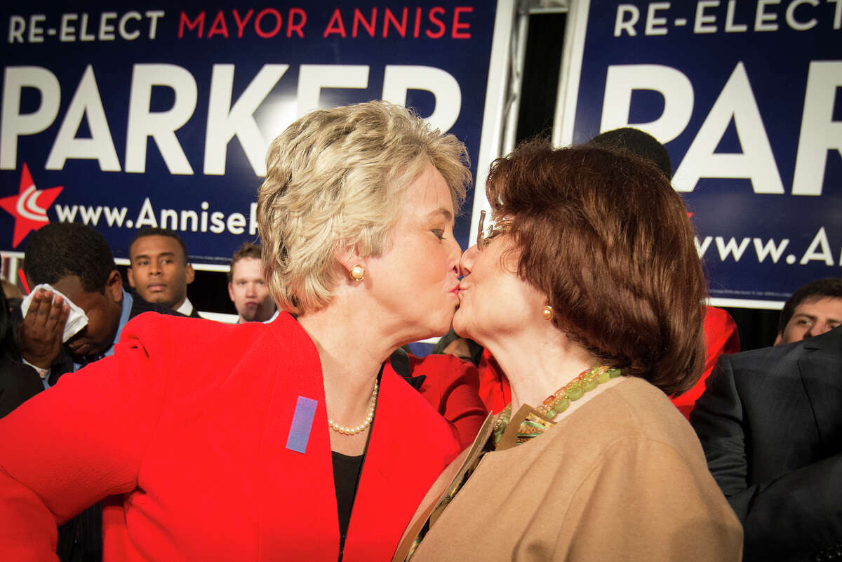 Houston mayor Annise Parker, left, kiss her partner Kathy Hubbard as she celebrates her election victory during a campaign party at the George R. Brown Convention Center on Tuesday, Nov. 5, 2013, in Houston. ( Smiley N. Pool / Houston Chronicle )