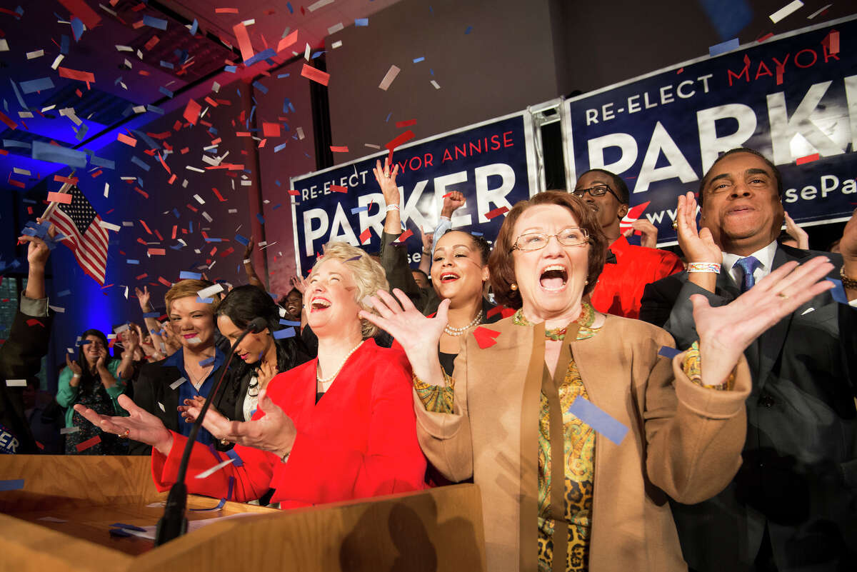Houston mayor Annise Parker, center, celebrates her election victory with her partner Kathy Hubbard, right, during a campaign party at the George R. Brown Convention Center on Tuesday, Nov. 5, 2013, in Houston. ( Smiley N. Pool / Houston Chronicle )