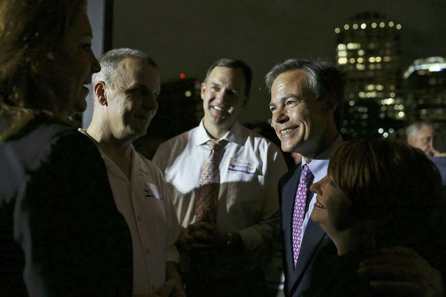 House Speaker Joe Straus of San Antonio talks with Proposition 6 supporters after the measure was passed. Photo: Lisa Krantz / San Antonio Express-News