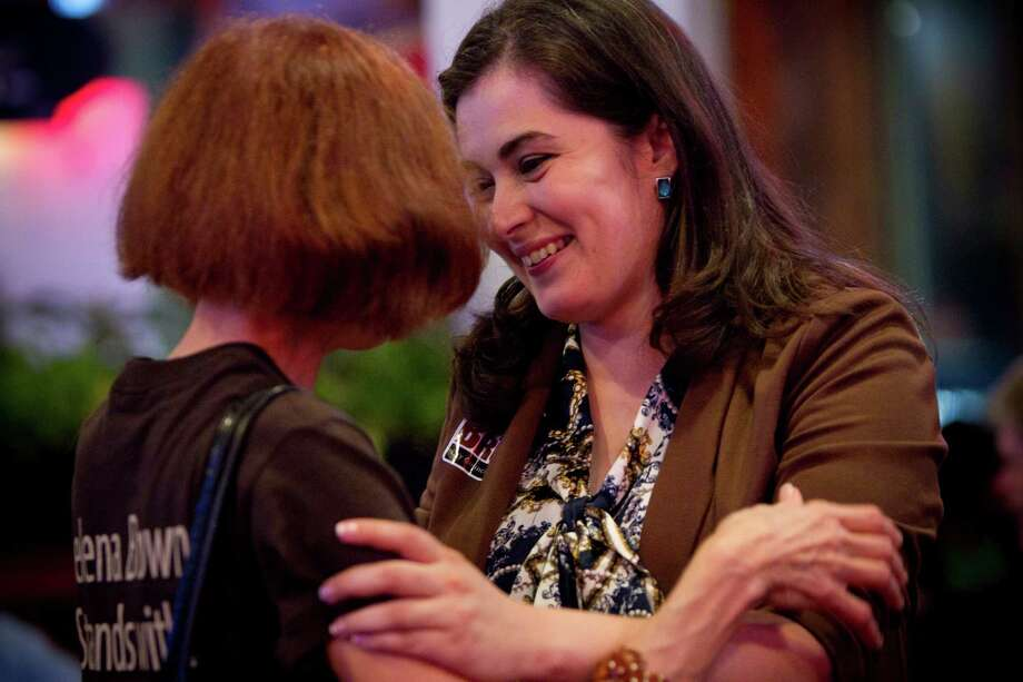 District A representative Helena Brown embraces supporter Mary Louise Charrin. Brown will face Brenda Stardig in a runoff. Photo: Marie D. De Jesus, Staff / © 2013 Houston Chronicle