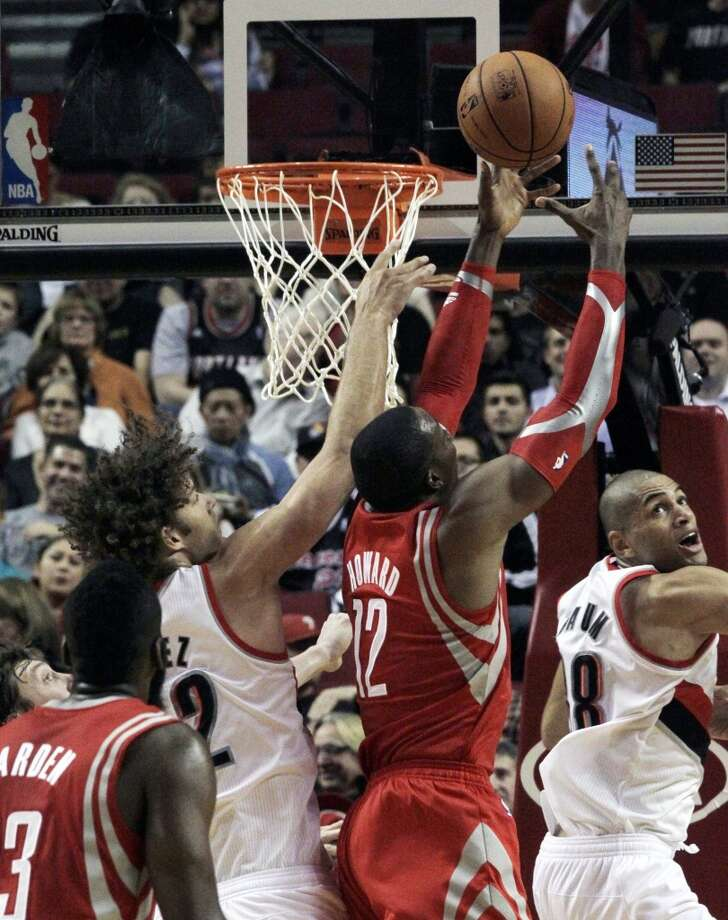 Nov. 5: Rockets 116, Trail Blazers 101Rockets forward Dwight Howard, second from right, pulls in a rebound against Robin Lopez, left, and Nicolas Batum. Photo: Don Ryan, Associated Press