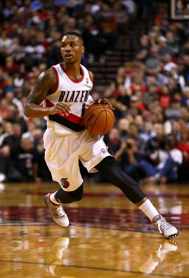 Damian Lilliard #0 of the Trail Blazers dribbles the ball. Photo: Jonathan Ferrey, Getty Images