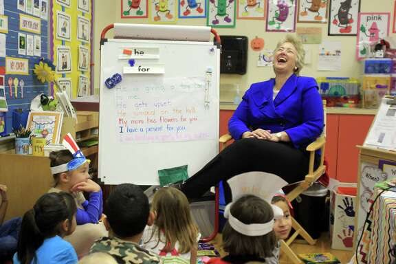 Mayor Annise Parker visits a kindergarten classroom at Roberts Elementary School on Tuesday after working outside the poll location on Election Day. The mayor was rewarded with a third term in office.