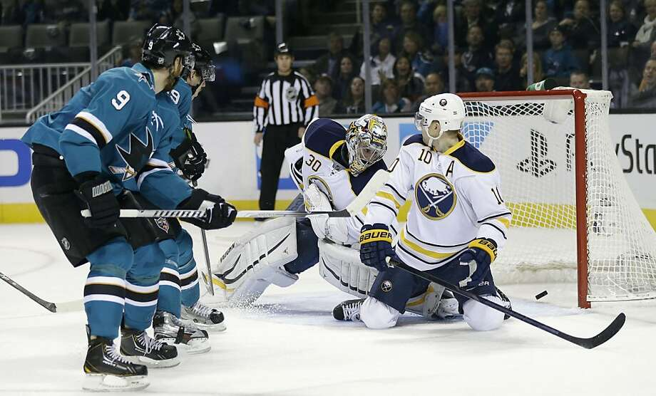 Marty Havlat (left) got the Sharks on the scoreboard first with a backhander that slipped under Sabres goalie Ryan Miller. Photo: Marcio Jose Sanchez, Associated Press