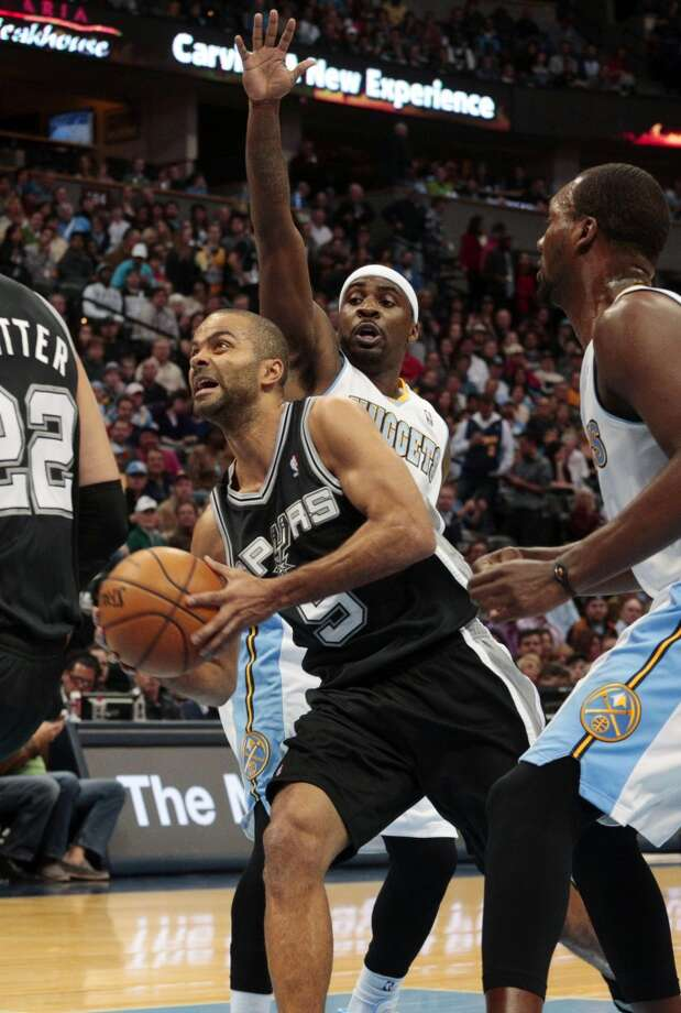 San Antonio Spurs guard Tony Parker (9) drives against Denver Nuggets guard Ty Lawson (3) in the first quarter of a basketball game in Denver on Tuesday, Nov. 5, 2013. San Antonio won 102-94. Photo: Joe Mahoney, Associated Press