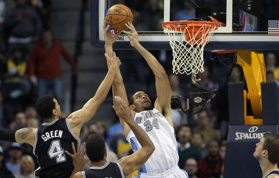 San Antonio Spurs guard Danny Green (4) fouls Denver Nuggets center JaVale McGee (34) in the first quarter of a basketball game in Denver on Tuesday, Nov. 5, 2013. Photo: Joe Mahoney, Associated Press
