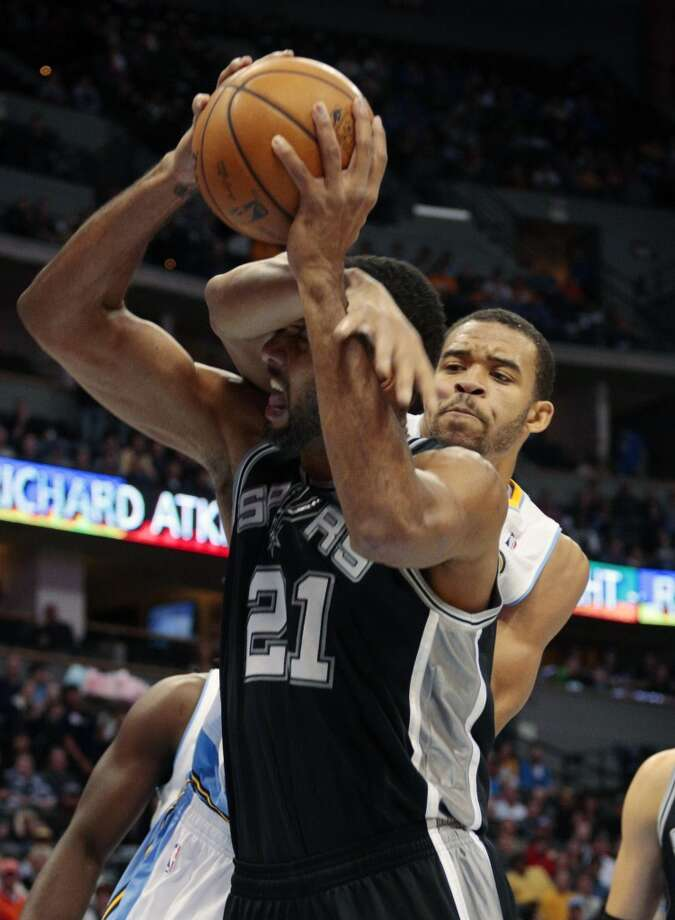 Denver Nuggets Javale McGee, right, fouls San Antonio Spurs forward Tim Duncan (21) in the first quarter of a basketball game in Denver on Tuesday, Nov. 5, 2013. Photo: Joe Mahoney, Associated Press