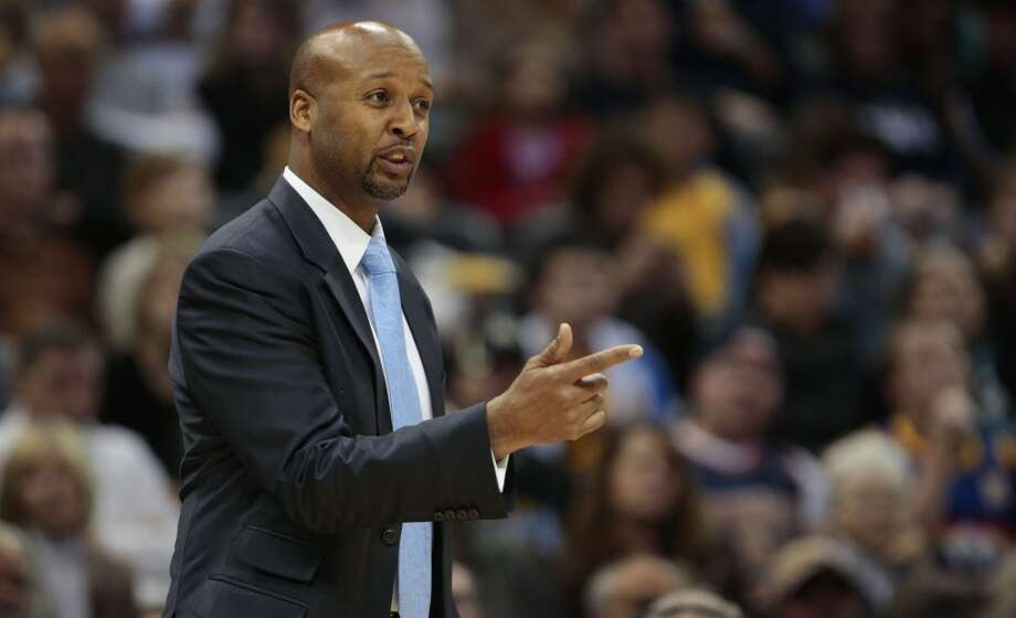 Denver Nuggets coach Brian Shaw talks to his players in the first quarter of an NBA basketball game against the San Antonio Spurs in Denver on Tuesday, Nov. 5, 2013. San Antonio defeated Denver 102-94. Photo: Joe Mahoney, Associated Press