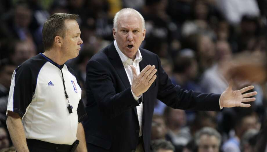 San Antonio Spurs coach Greg Popovich talks to referee Bill Spooner in the third quarter of the Spurs' NBA basketball game against the Denver Nuggets in Denver on Tuesday, Nov. 5, 2013. San Antonio defeated Denver 102-94. Photo: Joe Mahoney, Associated Press