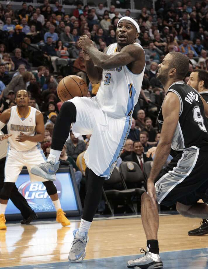 Denver Nuggets guard Ty Lawson (3) loses the ball as San Antonio Spurs guard Tony Parker (9) defends during the third quarter of an NBA basketball game in Denver on Tuesday, Nov. 5, 2013. San Antonio defeated Denver 102-94. Photo: Joe Mahoney, Associated Press