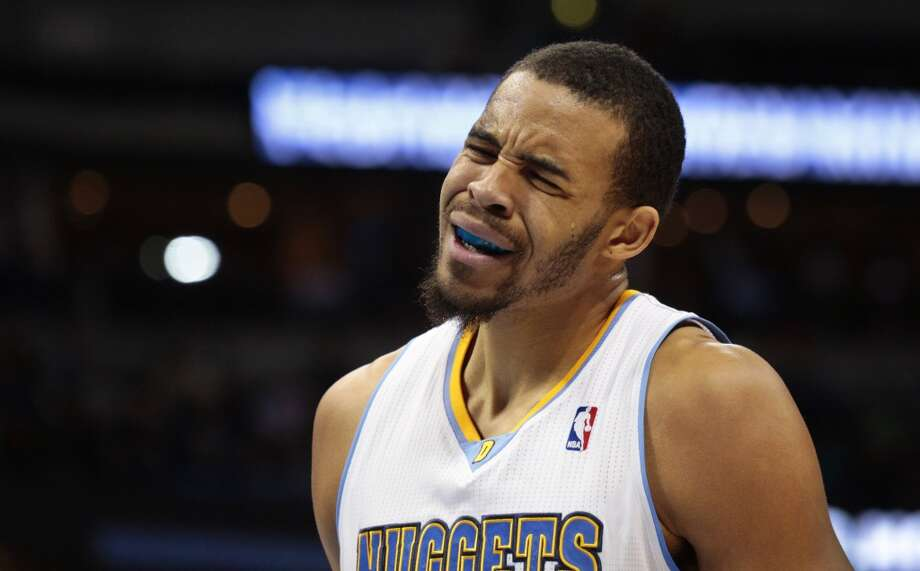 Denver Nuggets' Javale McGee reacts to committing a foul against the San Antonio Spurs in the first quarter of a basketball game in Denver on Tuesday, Nov. 5, 2013. San Antonio won 102-94. Photo: Joe Mahoney, Associated Press